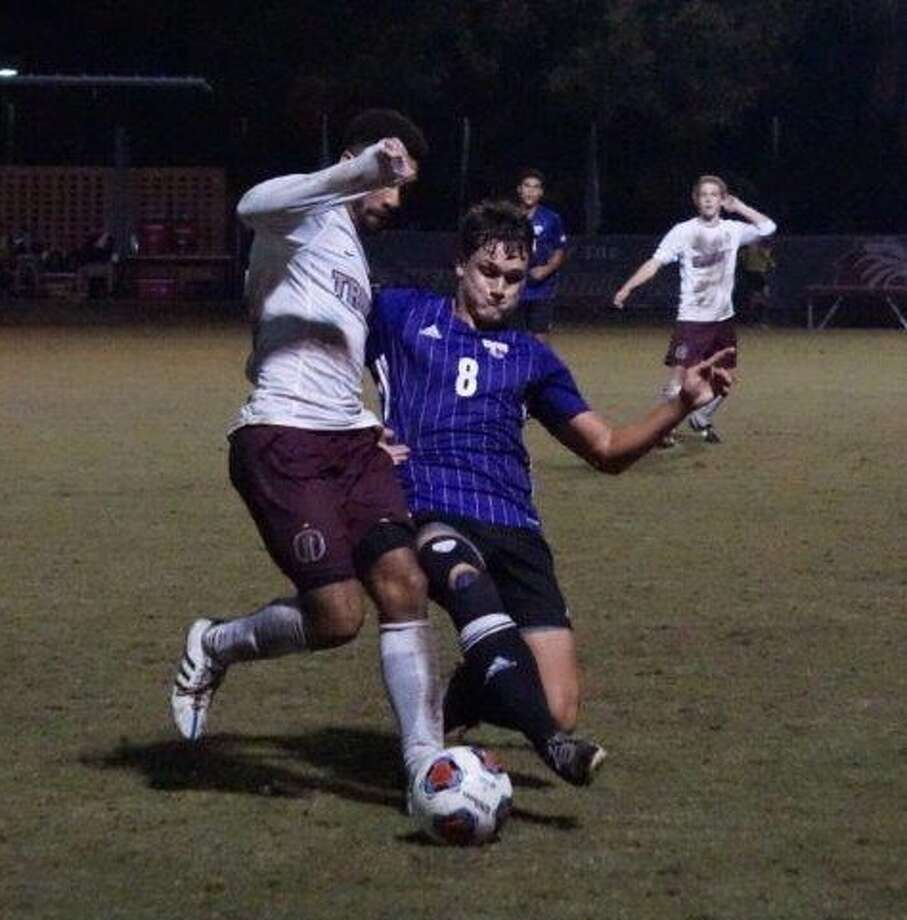 Mary Hardin-Baylor soccer player Logan Keeler, a Montgomery alum, and Trinity University's Wesley Mitchell, a The Woodlands alum, battle for the ball this past Saturday night in San Antonio. Photo: Photo Submitted