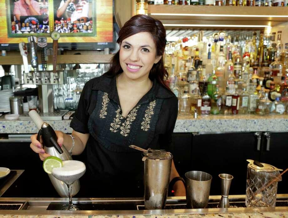 Bartender Janeen Gutierrez mixes a Zihuatanejo at  Caracol, 2200 Post Oak Blvd. Photo: Melissa Phillip, Houston Chronicle / © 2017 Houston Chronicle