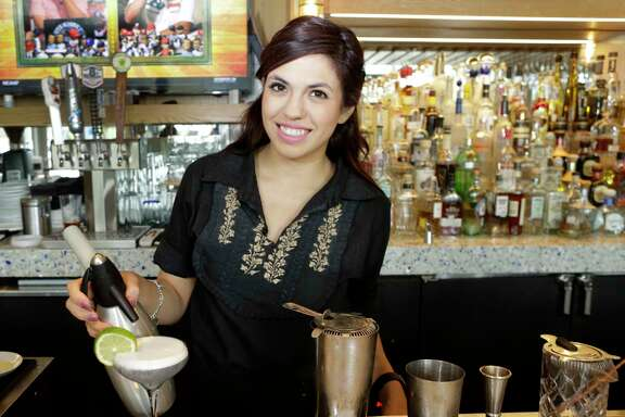 Bartender Janeen Gutierrez mixes a Zihuatanejo at  Caracol, 2200 Post Oak Blvd., Friday, Nov. 10, 2017, in Houston.  ( Melissa Phillip / Houston Chronicle )