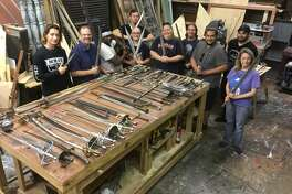 "College of the Mainland theater director and Friendswood resident H. Russ Brown, second from the left, and his students worked more than 240 hours to painstakingly remove rust that threatened stage weaponry of the Alley Theatre after the props were flooded during Hurricane Harvey. ""I was stunned,"" says Alley Theatre properties master Karin Rabe, center. ""I still owe them a pan of brownies."""