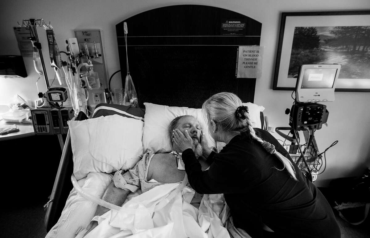 Michelle Puckett talks to her brother, Joel Fritsch, at Houston Methodist St. Catherine Hospital in Katy, where Fritsch is listed as being in a vegetative state two years after a his heart stopped during a medical operation, depriving his brain of oxygen.