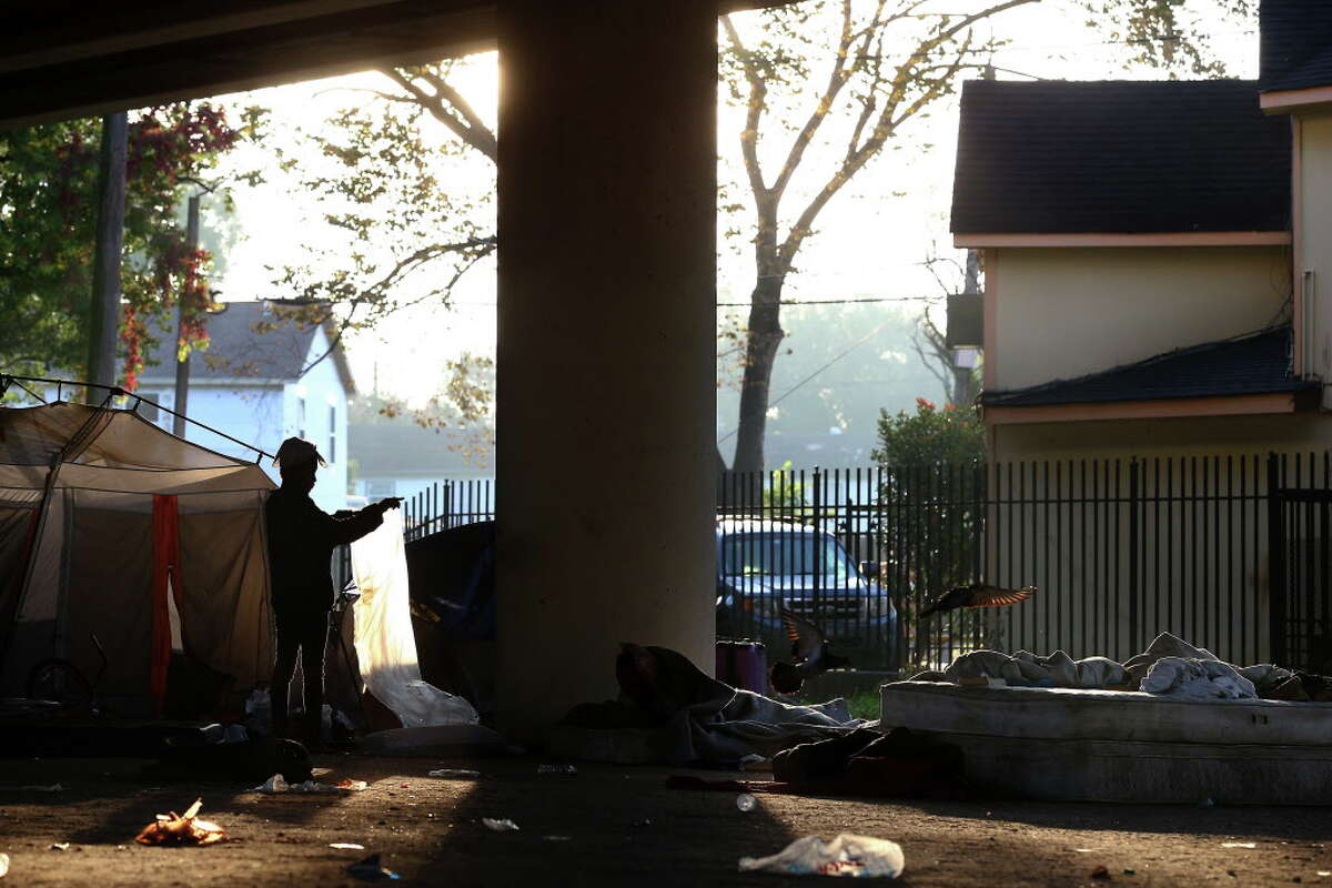 People living at the homeless encampment, located under the U.S. 59 Highway between Caroline Street and Almeda Road, were given plastic bags so that they can move their belongings before city officials cleaned up the area Wednesday, Nov. 15, 2017, in Houston.