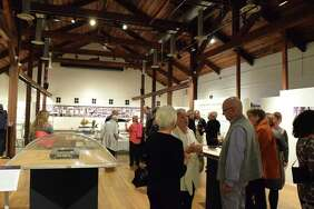 Attendees at the private preview event of New Canaan Modern Architects exhibit at Carriage Barn on Friday, November 3 2017 in New Canaan, CT.