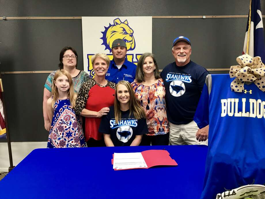 Kelly's Makasha Brown signs with Lamar State College-Port Arthur's softball team. (Mike Tobias/The Enterprise)