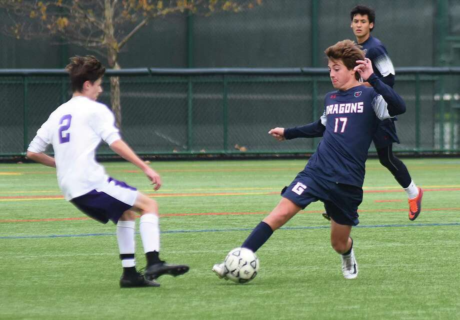 GFA's Charlie Benson, right, makes a move on a Masters (NY) player during last week's FAA boys soccer semifinal in Westport. Photo: Contributed Photo