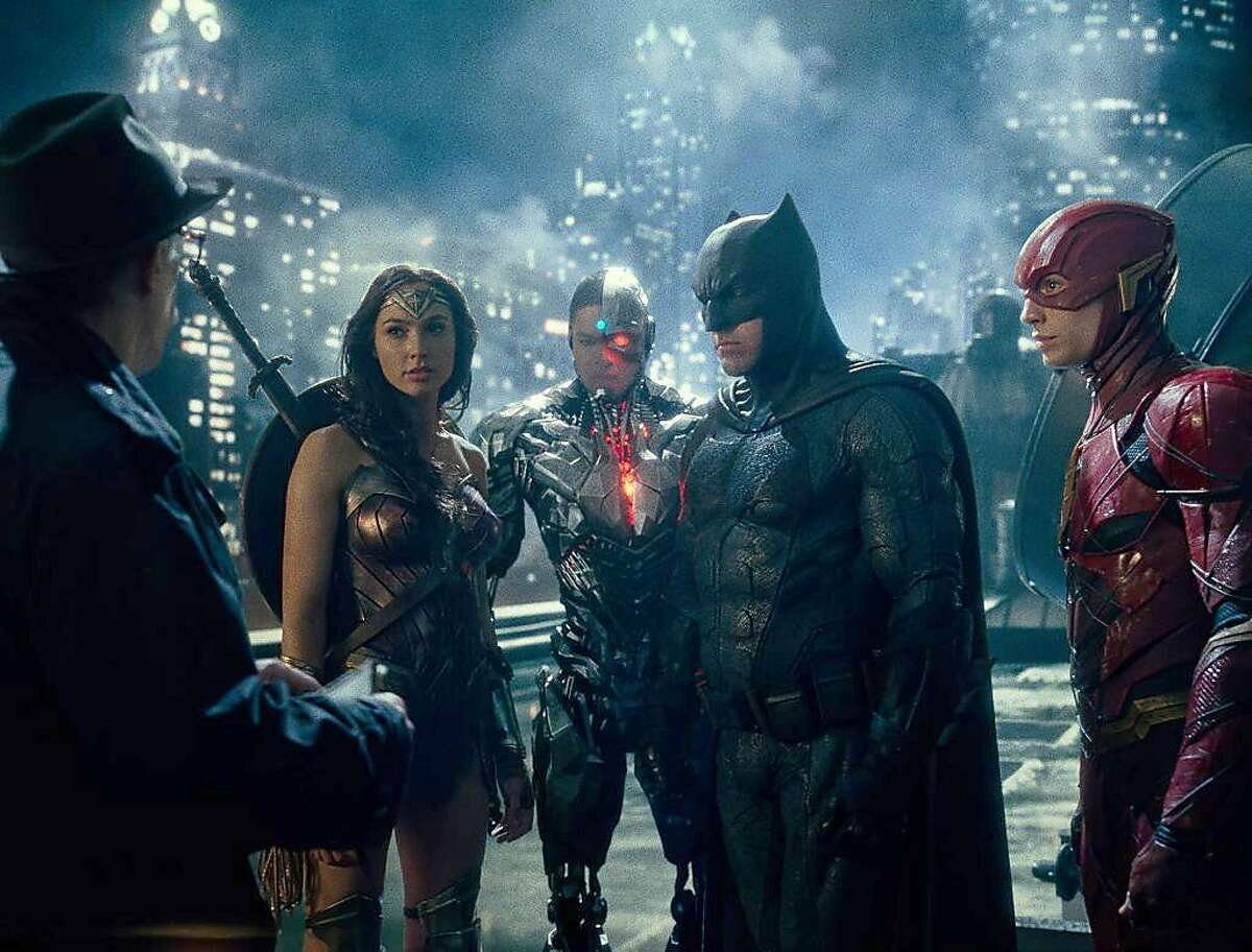 """Wonder Woman (Gal Gadot), Cyborg (Ray Fisher), Batman (Ben Affleck) and the Flash (Ezra Miller) meet with Commissioner Gordon (J.K. Simmons) in """"Justice League."""" MUST CREDIT: Warner Bros.-DC Entertainment"""