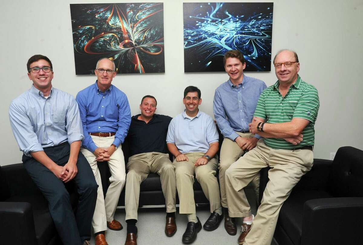 The Olympus Partners team, from left, associate Michael Cueter, managing partner Jim Conroy, partner Jason Miller, partner Evan Eason, vice president Griffin Barsis and managing partner Rob Morris pose for a photo inside the Olympus Partners office in Stamford, Conn., on Wednesday, Sept. 20, 2017.