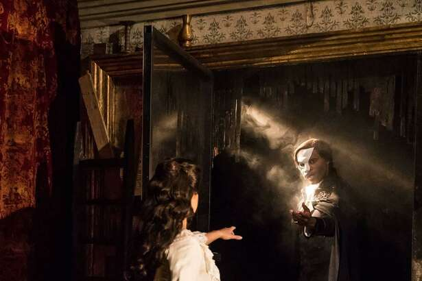"""Christine, played by Eva Tavares and the Phantom, played by Derrick Davis, in a scene from """"Phantom of the Opera"""" at the Palace Theater in Waterbury."""