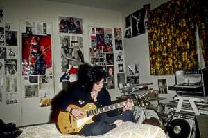 """LOS ANGELES - DECEMBER 1976: Guitarist Joan Jett of the rock band """"The Runaways"""" poses for a portrait in her bedroom at her family's home in Canoga Park just outside Los Angeles, CA in 1977. (Photo by Michael Ochs Archives/Getty Images)"""