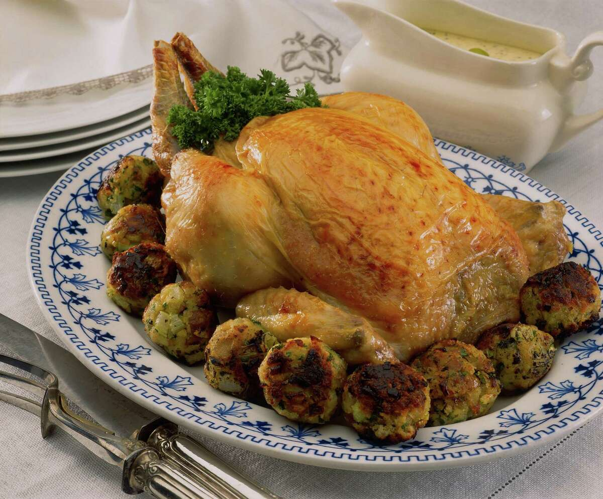 Rolling Thanksgiving stuffing into balls before baking provides more crunchy bites than baking in a pan.