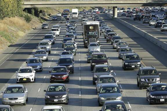 In this photo taken Monday, Oct. 30, 2017, vehicles crowd Highway 50 in Sacramento, Calif. Gasoline taxes will rise by 12 cents per gallon Wednesday, Nov., 1, to raise money for fixing roads and highways. It is the first of several tax and fee hikes that will take effect after they were approved by the Legislature earlier this year. (AP Photo/Rich Pedroncelli)