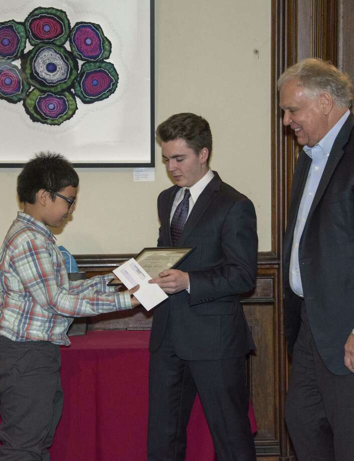From left to right, Aidan Erive, (Naramake Elementary), Robert Jon Hemingway and Superintendent of Norwalk Schools Dr. Steven J. Adamowski at the 2016 awards ceremony for the Lockwood-Mathews Mansion Museum/Ernest Hemingway/Young Writers' Competition. Photo: Contributed Photo: Sarah Grote Photography