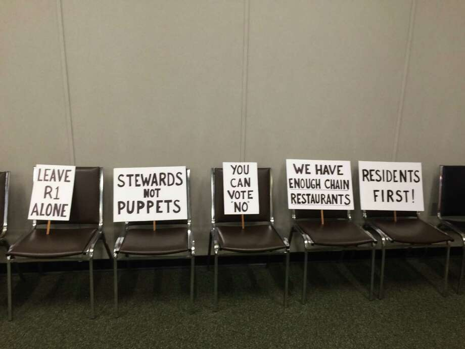 Signs posted by Save Our Shelton at the Nov. 14, 2017 Planning and Zoning Commission which marked the end of Ruth Parkins' tenure Photo: / Michael P. Mayko