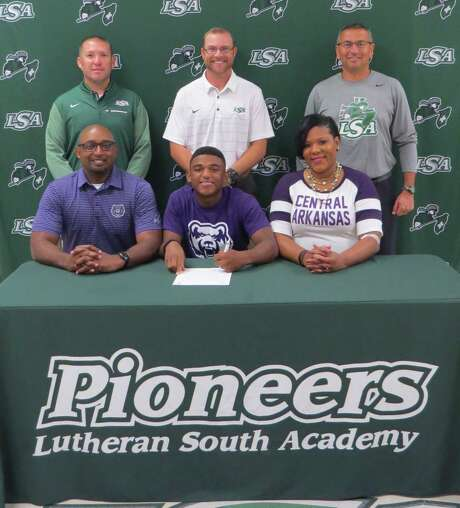 Lutheran South Academy pitcher Kolby Johnson has signed a national baseball letter of intent with Central Arkansas. Kolby is shown with his parents, Sylvester and Katrina Johnson along with (back row) LSA baseball coaches A.J. Bettcher, Aaron Schneider and Tom de la Garza. Photo: Courtesy Photo