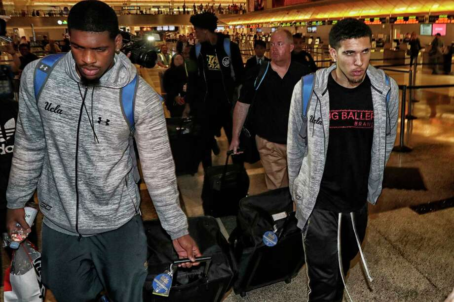 UCLA basketball players caught shoplifting while on a team trip to China, Cody Riley, left, Jalen Hill, center back, and LiAngelo Ball, return from Shanghai at Los Angeles International Airport on Tuesday, Nov. 14, 2017. Photo: Robert Gauthier, TNS / Los Angeles Times