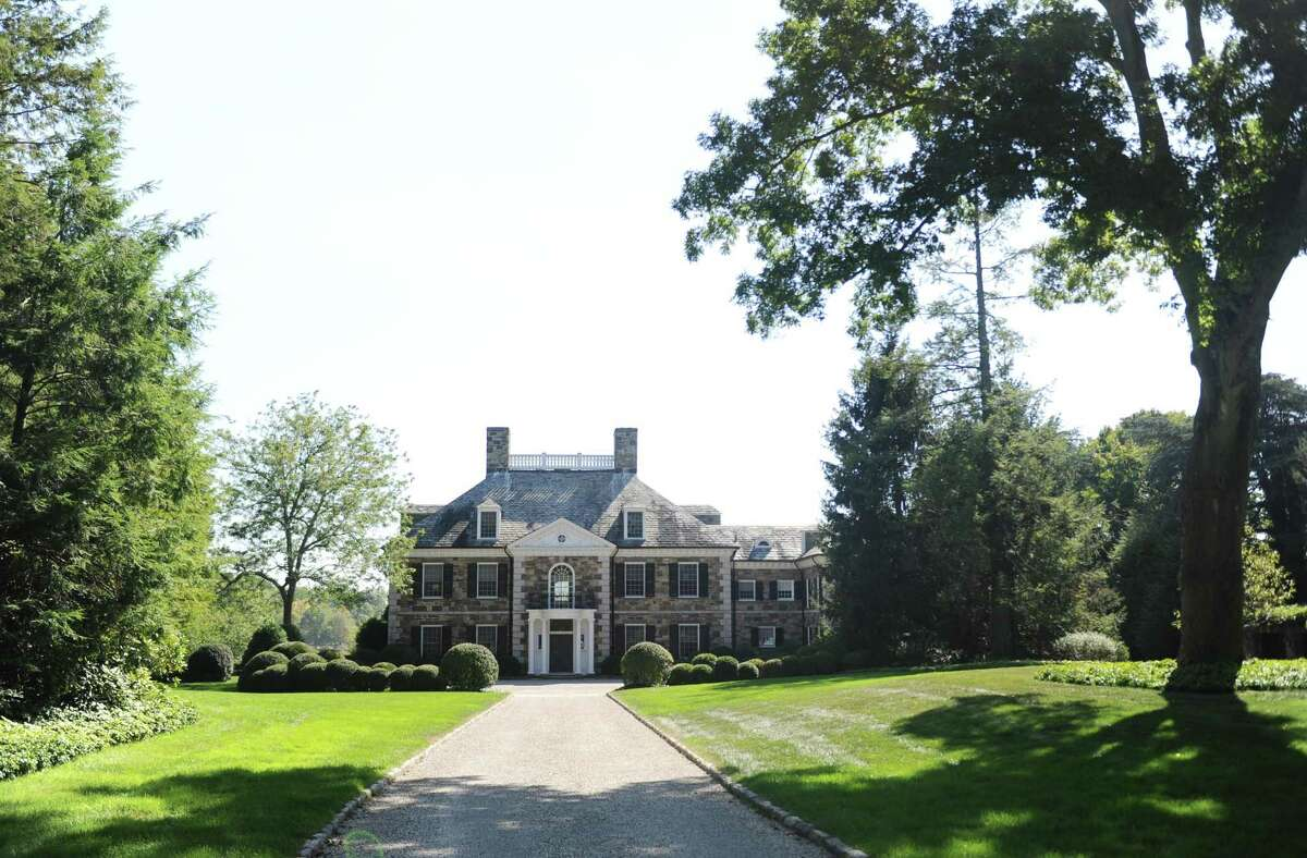 This Georgian colonial mansion on Oneida Dr. in Greenwich, Conn., photographed here on Wednesday, Oct. 4, 2017, sold last month for more than $20 million. The 9,780 sq. ft. home sits on nearly four acres in a gated community on Indian Harbor.
