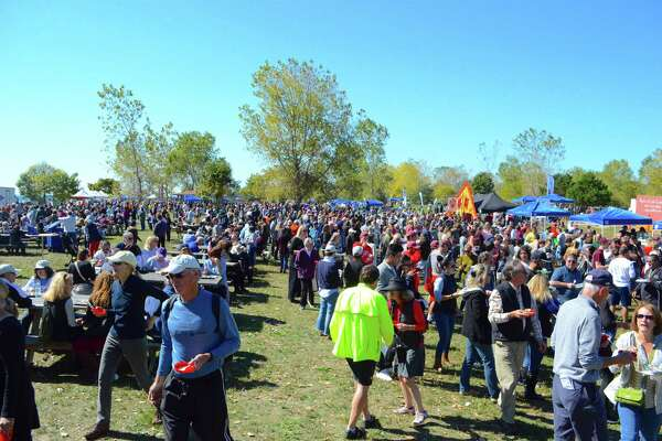 Crowds throng the 10th annual New England Chowdafest in early October 2017 in Westport, Conn., one of a multitude of festivals year-round that economic development officials tout as among the region's draws for families. In 2015, southwestern Connecticut gained more than 6,200 new residents on a net basis from the New York City region, according to newly updated Census Bureau data published Nov. 15, 2017.