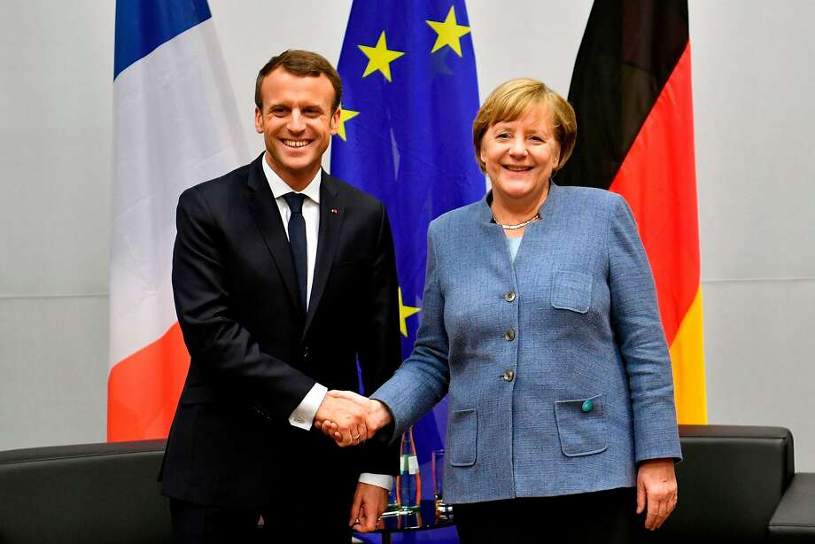 French President Emmanuel Macron (R) shakes hands with German Chancellor Angela Merkel during bilateral talks on the sidelines of the UN conference on climate change (COP23) on November 15, 2017 in Bonn, western Germany.  Photo: JOHN MACDOUGALL, AFP/Getty Images