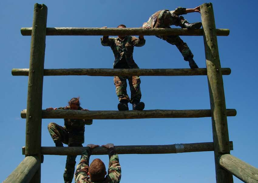 Army reservists from the 90th Regional Readiness Command maneuver their way through an obstacle course at Camp Bullis. Troops there had been preparing themselves for the types of warfare situations encountered in Iraq.