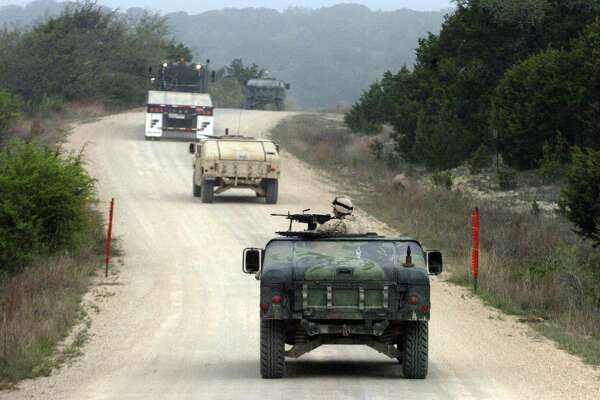 Air Force personnel train at Camp Bullis during a Basic Combat Convoy Course on Monday April 3, 2006. Airmen are trained there to secure convoys travelling through Iraq. JOHN DAVENPORT / STAFF