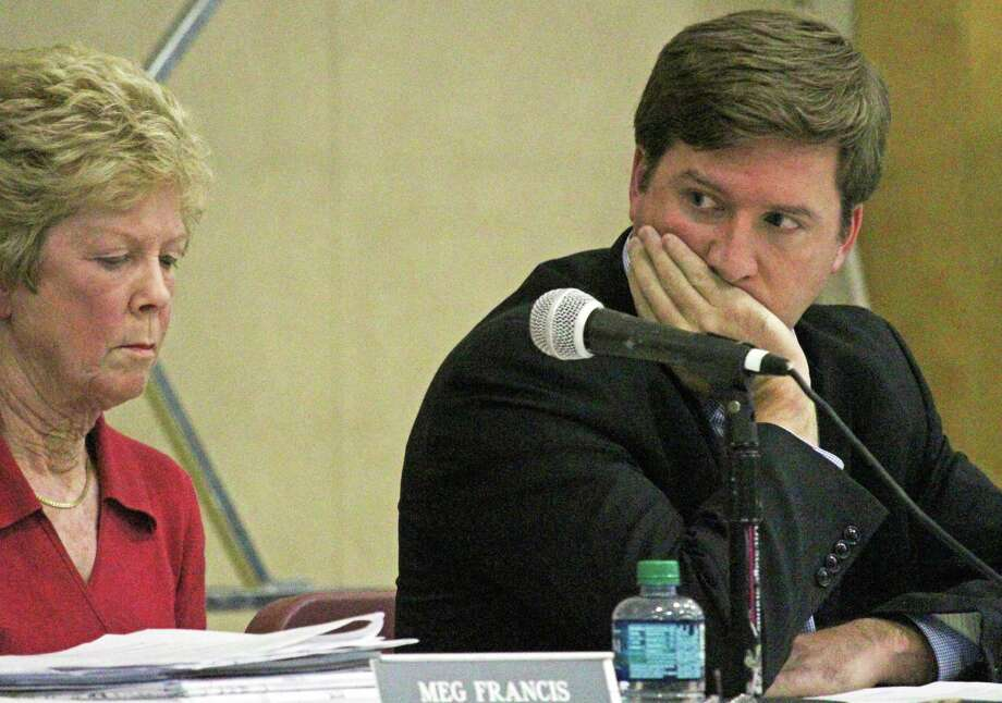 The Town Plan and Zoning Commission turned down a zone change for a sports bar on Black Rock Turnpike. From left, commission members Meg Francis and Thomas Noonan. Fairfield,CT. 11/15/17 Photo: Genevieve Reilly / Hearst Connecticut Media / Fairfield Citizen