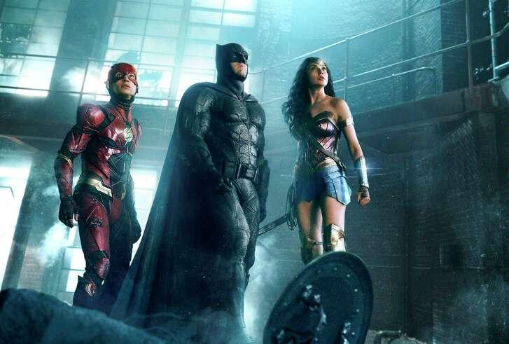 "Ezra Miller (The Flash), Ben Affleck (Batman) and Gal Gadot (Wonder Woman) are featured in ""Justice League."""