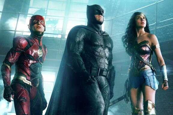 "Ezra Miller (The Flash), Ben Affleck (Batman) and Gal Gadot (Wonder Woman) are featured in ""Justice League."""
