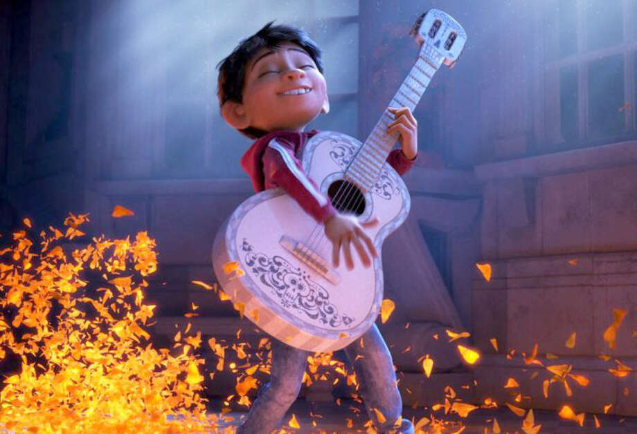 With coco we are no longer invisible houston chronicle miguel has a dream to make music in pixars new coco photo stopboris Image collections