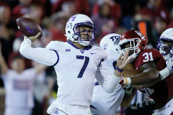 TCU quarterback Kenny Hill (7) during an NCAA college football game between TCU and Oklahoma in Norman, Okla., Saturday, Nov. 11, 2017. Oklahoma won 38-20. (AP Photo/Sue Ogrocki)