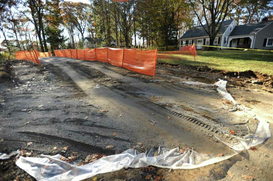 A section of Poplar Drive in Shelton is closed to traffic after a car striking a utility pole on November 5 caused PCB chemicals to be spilled on the roadway. Photo: Brian A. Pounds / Hearst Connecticut Media / Connecticut Post