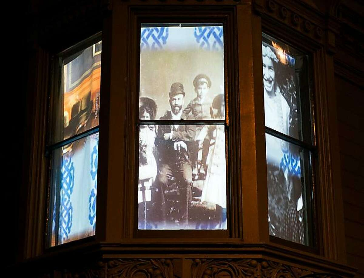 Windows of Haas-Lilienthal house with video projection by Ben Wood