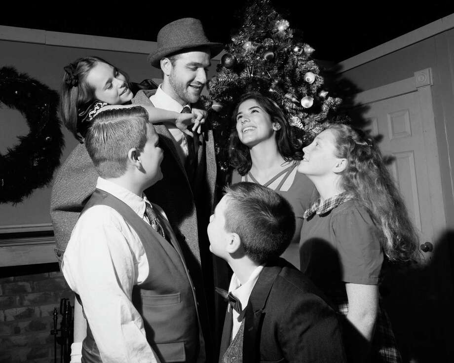 "The cast of Landmark Community Theater's production of  ""It's A Wonderful Life"" re-create the iconic end shot of the film. From top: Madeline Roberts as ""Zuzu Bailey,"" Rob Girardin as ""George Bailey,"" Jenny Dressel as ""Mary Bailey,"" Abby Stanford as ""Janie Bailey,"" Lucas Peck as ""Tommy Bailey,"" and Ethan Wollman as ""Peter Bailey."" Photo: Contributed Photo /Not For Resale / LisaCherie"
