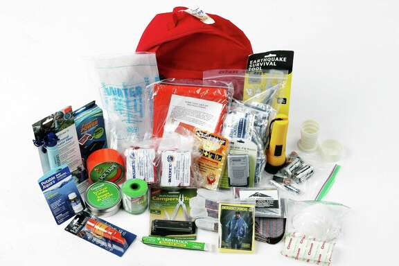 An emergency backpack for your car should contain a first aid kit, water, food, a blanket and other disaster-preparedness supplies.