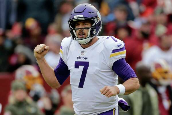 Minnesota Vikings quarterback Case Keenum celebrates a touchdown during an NFL football game against the Washington Redskins, Sunday, Nov. 12, 2017, in Landover, Md. (AP Photo/Mark Tenally)
