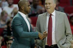 Point guard Chris Paul, left, spent a lot of time next to Rockets coach Mike D'Antoni on the bench as Paul worked his way back from a bruised knee.
