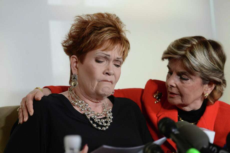 Beverly Young Nelson, comforted by attorney Gloria Allred, appears at a press conference to accuse Roy Moore, the Alabama Republican Senate candidate, of sexually attacking her when she was a teenager and he was an assistant district attorney. A reader condemns those who defend Moore against allegations of sexual misconduct. Photo: Susan Watts /TNS / New York Daily News