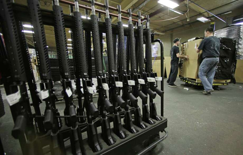 FILE - Newly made AR-15 rifles stand in a rack in New Britain, Conn in 2013. Firearms distributor United Sporting Cos. filed for Chapter 11 bankruptcy in Delaware after miscalculating consumer habits following the 2016 election. Photo: Charles Krupa /Associated Press / AP