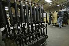 America has more guns than people and it's said that we need guns to keep us safe. But America is not safe - it is suffering a plague of gun violence. This makes no sense. Shown here, newly made AR-15 rifles stand in a rack at Stag Arms in New Britain, Conn in 2013.