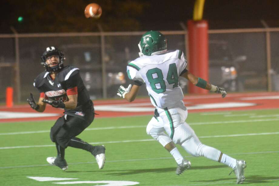 Lockney receiver Israel Cuellar waits for a pass as Floydada's Gerry Reyes, 84, tries to catch up during a game earlier this season. Cuellar leads the Longhorns with six touchdown receptions and also has seen time in the backfield at running back. Photo: Skip Leon/Plainview Herald