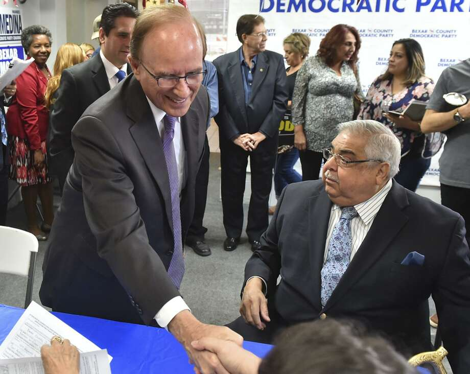 Bexar County Judge Nelson Wolff (left) and Commisioner Paul Elizondo file for re-election at Democratic headquarters. The two veteran political leaders say this will be their last campaign. At least one reader is shedding no tears. Photo: Robin Jerstad /San Antonio Express News / ROBERT JERSTAD