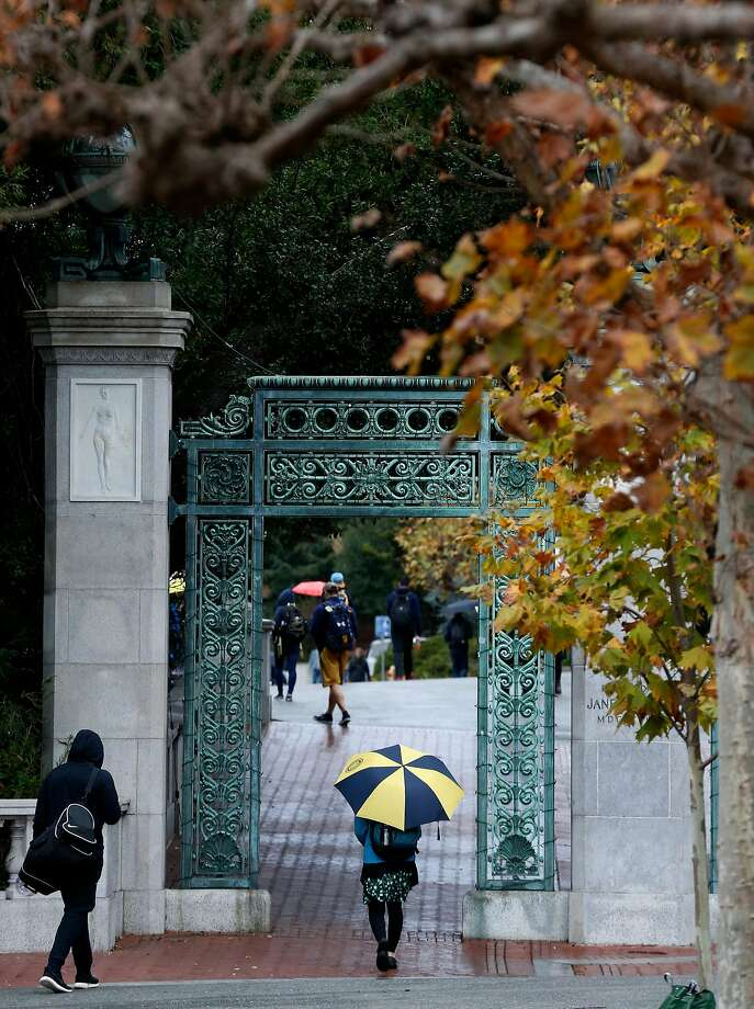 Students walk through Sather Gate during light rain at UC Berkeley. Heavy rain is expected to fall in the Bay Area. Photo: Paul Chinn, The Chronicle