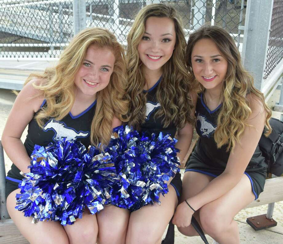 Friendswood High School cheerleader Rachel Epperson, center, shown with squad members Madison Stephens and Taylor Jeter, is vying to be Miss Texas Teen USA.
