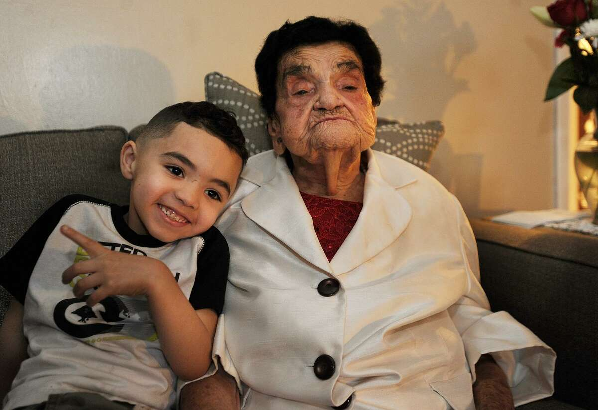 Ernesta Garcia, who just turned 107-years-old, sits with her great-great-grandson Mason Cora, 3, in her apartment in Bridgeport, Conn. on Thursday, November 9, 2017.
