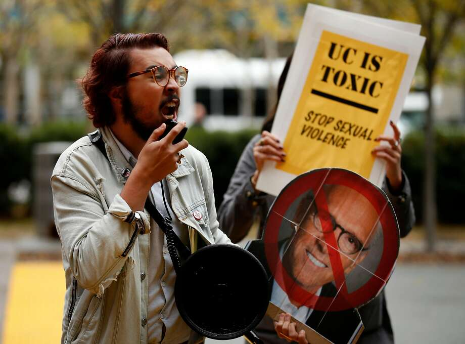 Justin Deckard, holding a cardboard head of UC Regent Norman Pattiz, protests outside a regents meeting in S.F. Photo: Santiago Mejia, The Chronicle
