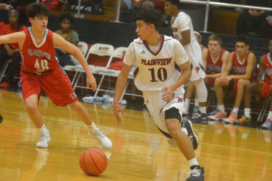 Plainview's Adrian Hinojosa, 10, dribbles around a Lubbock Monterey defender in a game at the Dog House Tuesday night. The senior guard scored 28 points in the opening game, but Monterey prevailed, 85-76. Photo: Skip Leon, Plainview Herald