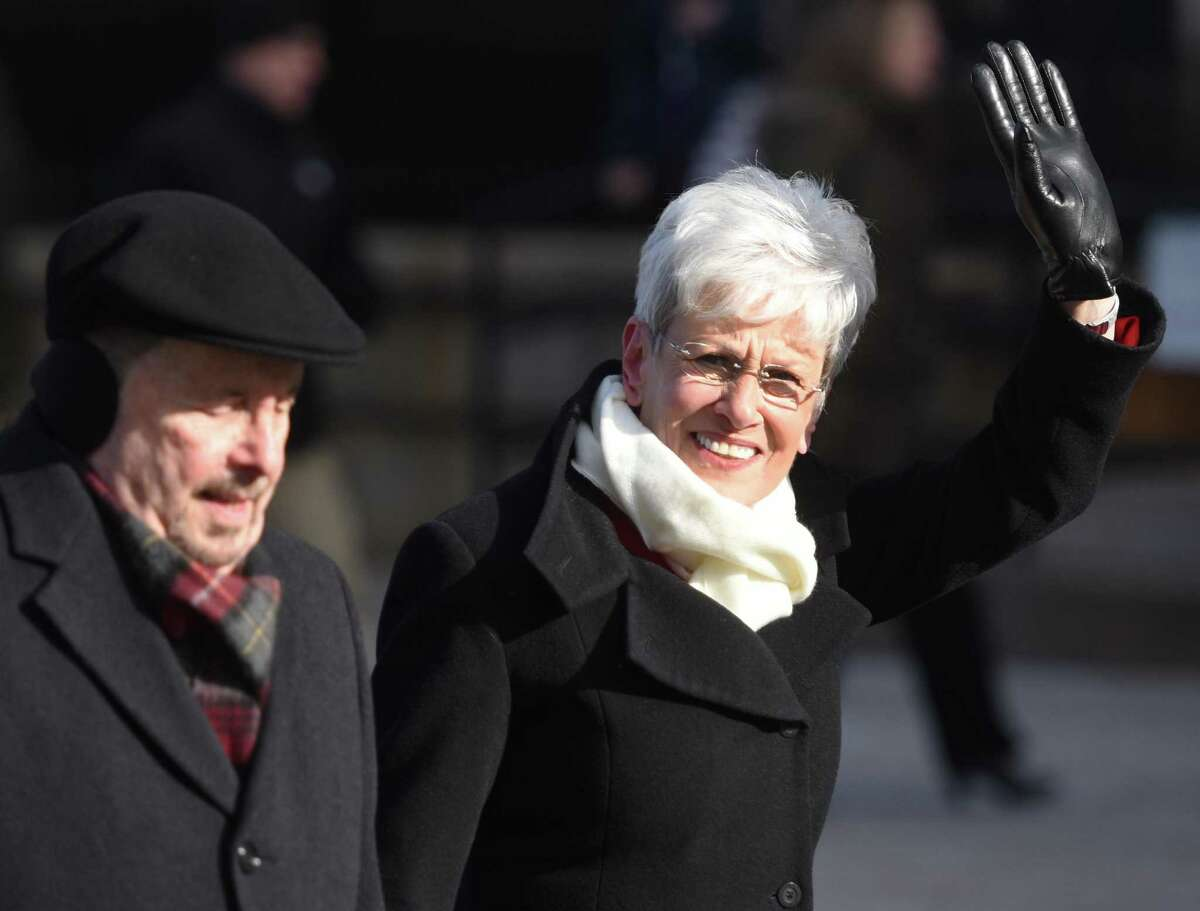 Lt. Gov. Nancy Wyman and her husband, Michael Wyman, walk in the inaugural parade outside of the state Capitol in Hartford in 2015.