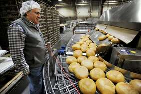 Vice President of Sales and General Manager Vito Catale gives a tour of the automated bread making operation at Chaves Bakery at 1365 State Street in Bridgeport, Conn. on Tuesday, November 14, 2017.