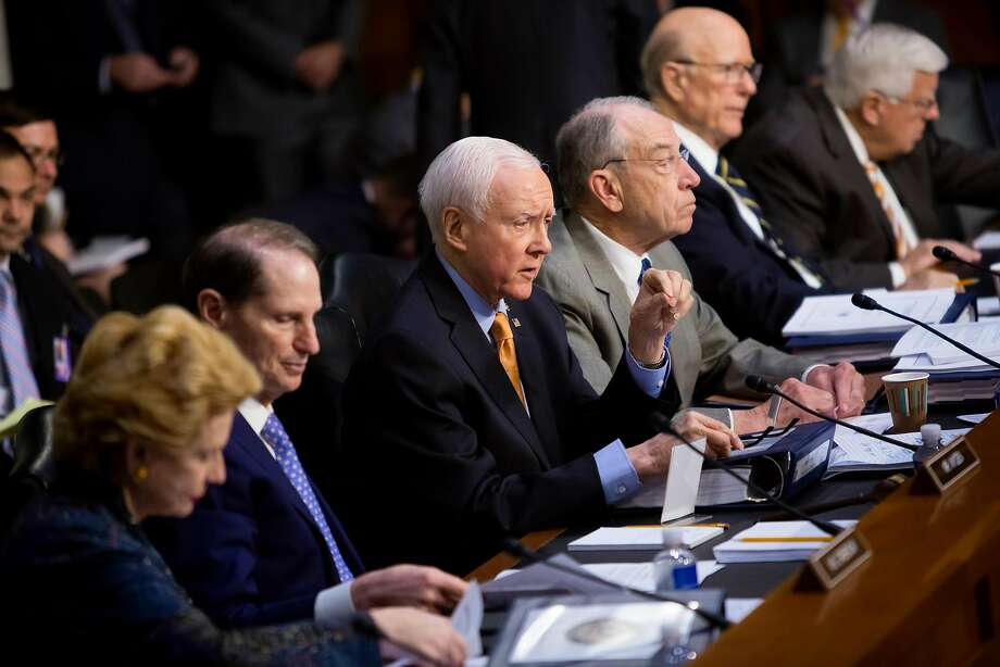 Sen. Orrin Hatch (R-Utah), center, speaks during a Senate Finance Committee executive session on tax policy, on Capitol Hill on Wednesday. Senate Republicans are including the repeal of the Affordable Care Acts individual mandate in their tax proposal. Photo: ERIC THAYER, NYT