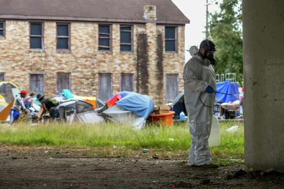 City contractors power-wash the pillars under U.S. 59 Highway, where a homeless encampment is located between Caroline Street and Almeda Road Wednesday, Nov. 15, 2017, in Houston. ( Godofredo A. Vasquez / Houston Chronicle )