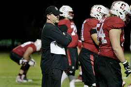 Mike Bloomgren, Stanford�s Andrew Luck Director of Offense, works with members of the Stanford Cardinal football team during practice on Tuesday, November 14,  2017 in Stanford, Calif. Bloomgren serves as the associate head coach, offensive coordinator and offensive line coach.